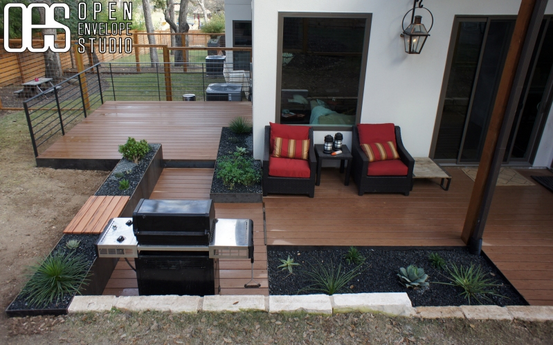 Open Envelope Studio|cedar deck with steel planters and built in seating