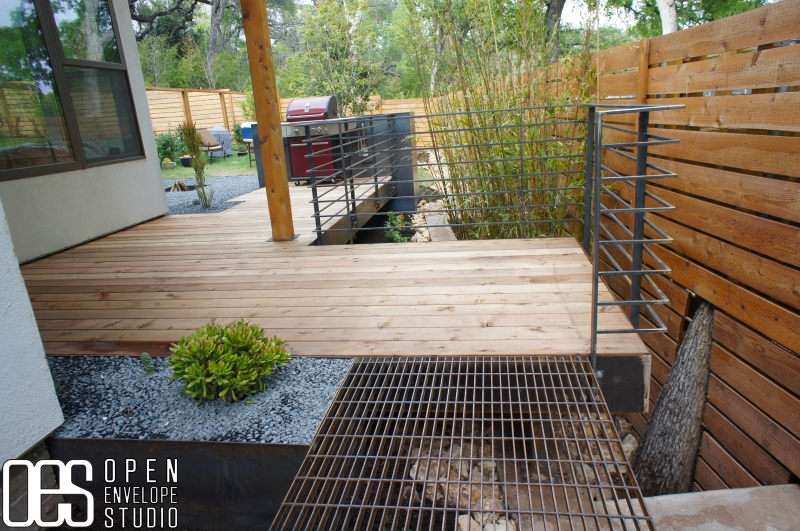 Open Envelope Studio|cedar deck with sunken fire pit framed by clumping bamboo and bunch grasses