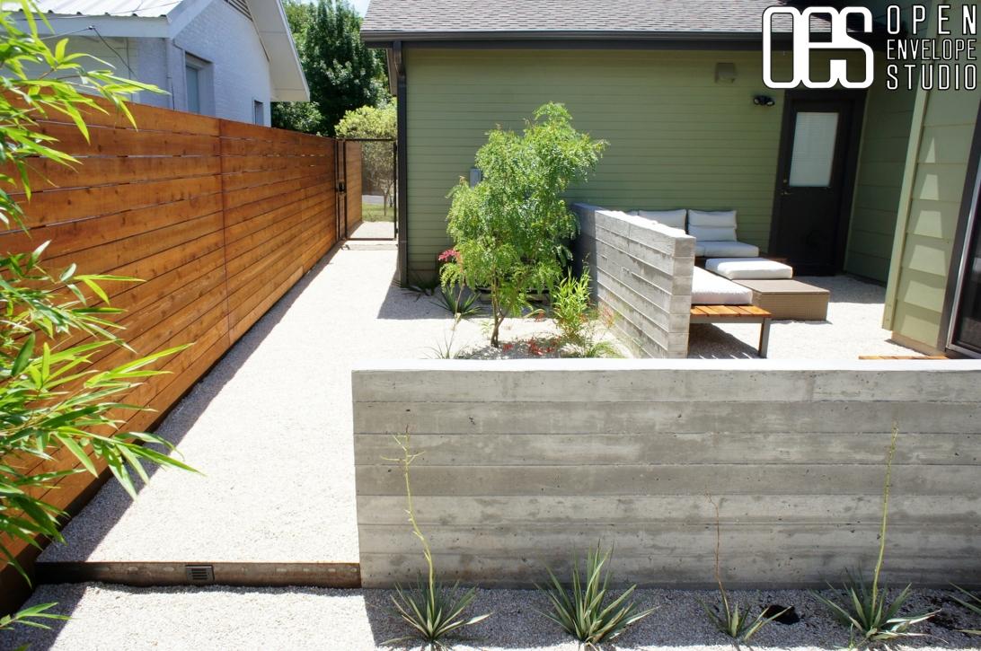 OES  Board form concrete walls, custom bench, horizontal fence, native plants