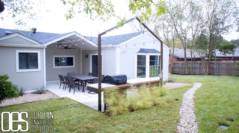 OES   Backyard with custom steel grill structure and string lights
